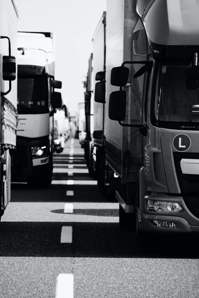 grayscale photo of cars on road
